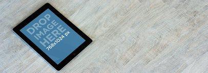 iPad Black Portrait Over Grey Wooden Table