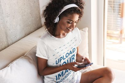 Tee Mockup of a Smiling Woman Listening to Music at Home 34848-r-el2