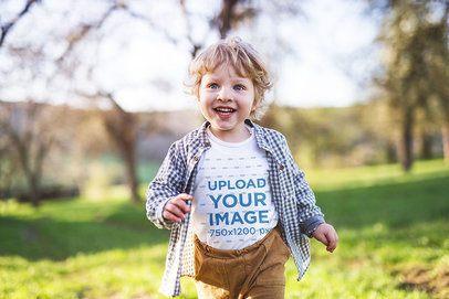 Onesie Mockup Featuring a Little Boy Running Outside 34778-r-el2