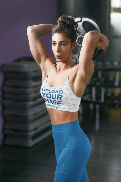 Sports Bra Mockup of a Woman Doing an Arm Workout at the Gym 38383-r-el2