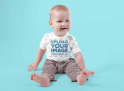 Onesie Mockup Featuring a Joyful Baby Sitting Against a Colored Backdrop 35683-r-el2