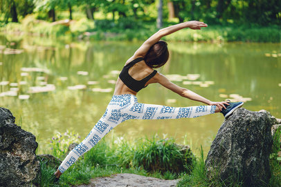 Back View Mockup of a Woman with Leggings Stretching Near a Pond 38392-r-el2