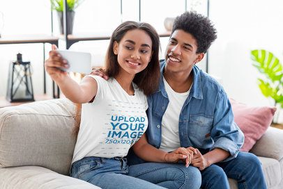 T-Shirt Mockup Featuring a Young Couple Taking a Selfie on a Couch 39038r-el2