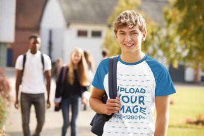 Mockup of a Teenager Wearing a Raglan T-Shirt Outside School 39083-r-el2
