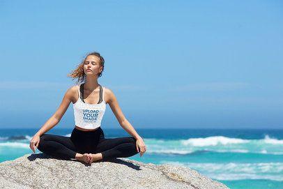 Tank Top Mockup of a Woman Enjoying the Sea Breeze While Meditating 38473-r-el2
