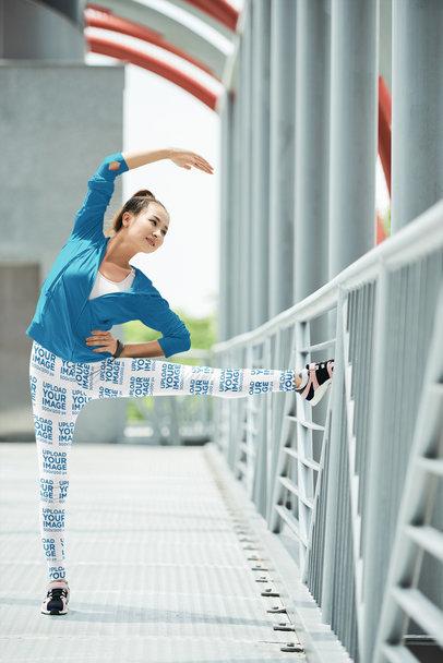 Leggings Mockup of a Woman Stretching Before Running 35836-r-el2