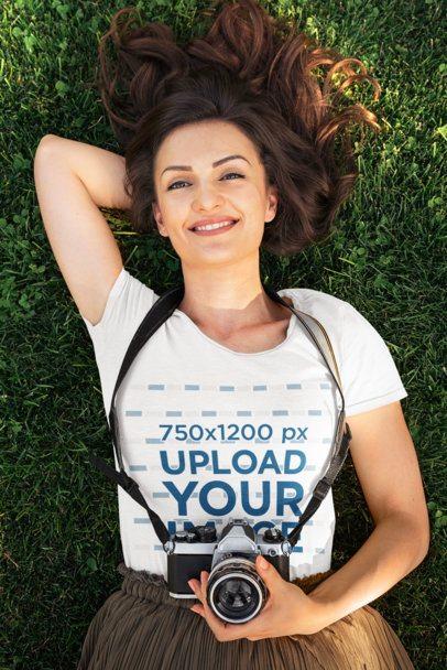 T-Shirt Mockup of a Happy Woman Lying on the Grass 38025-r-el2