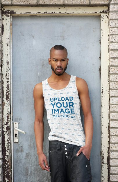 Mockup of a Man with a Heathered Tank Top Leaning on a Metal Door 38215-r-el2