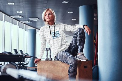 Mockup of a Woman Wearing a Heathered Hoodie at the Gym 40102-r-el2