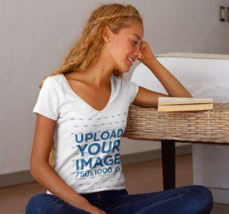 V-Neck T-Shirt Mockup of a Woman Reading at Home 7796