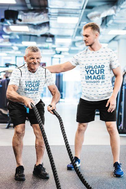 Sublimated Tee Mockup of a Coach Training an Elderly Man at a Gym 35129-r-el2