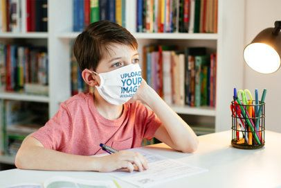 Face Mask Mockup Featuring a Serious Kid Studying 40523-r-el2