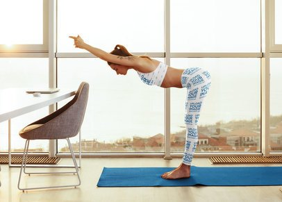 Sports Bra and Leggings Mockup of a Woman Stretching Her Back with a Yoga Pose 35270-r-el2