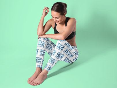 Leggings Mockup Featuring a Woman Sitting in a Studio 15587a