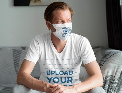 Face Mask and T-Shirt Mockup of a Man Relaxing in His Living Room 40345-r-el2