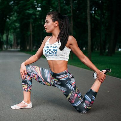 Sports Bra Mockup of a Female Runner Stretching Her Legs 34838-r-el2