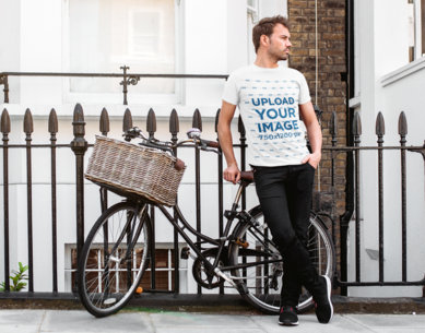 T-Shirt Mockup of a Man Posing with an Urban Bike 40114-r-el2