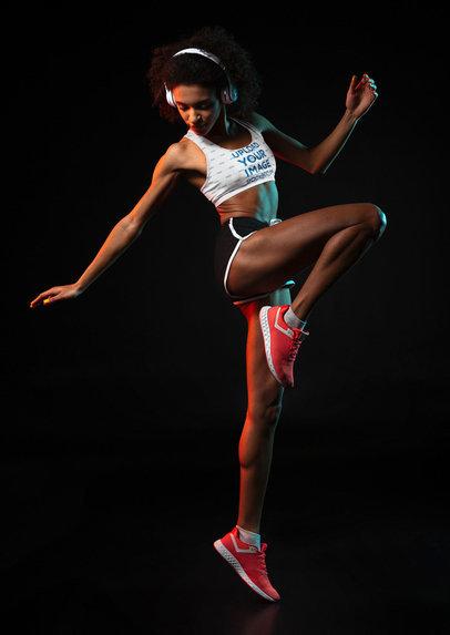 Sports Bra Mockup of a Woman Doing a Dynamic Jump 37719-r-el2