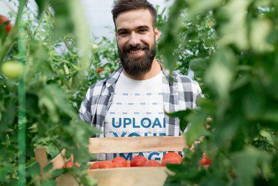 Tee Mockup of a Joyful Farmer Carrying a Tomato Box 40367-r-el2