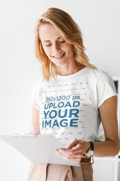 Mockup Featuring a Woman with a Round-Neck T-Shirt Taking Notes 36301-r-el2