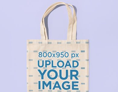 Closeup-View Mockup of a Sublimated Tote Bag on a Customizable Surface 41704-r-el2-