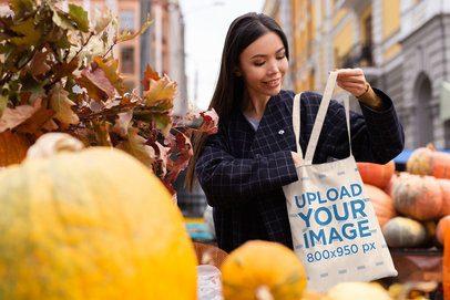 Tote Bag Mockup of a Woman Buying Pumpkins 41754-r-el2
