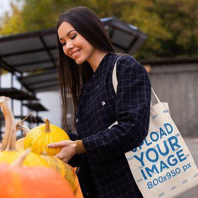 Grocery Bag Mockup Featuring a Happy Woman Buying a Pumpkin 41755-r-el2