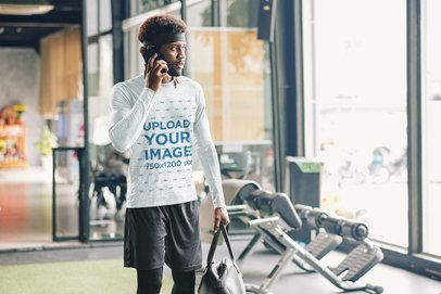 Heather Long-Sleeve Tee Mockup Featuring a Man Talking on the Phone at the Gym 40078-r-el2