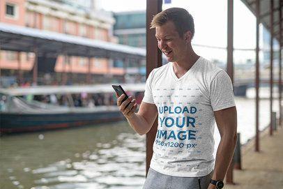 V-Neck T-Shirt Mockup of a Man Checking His Phone 41162-r-el2