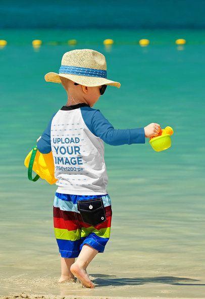 Mockup of a Toddler Wearing a Raglan Long Sleeve Tee by the Beach 42124-r-el2