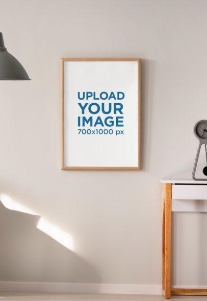 Mockup of an Art Print Hanged on a Natural Illuminated Wall 36095-r-el2
