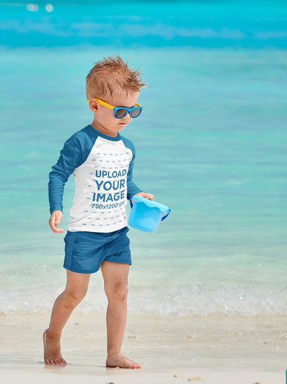 Mockup of a Little Boy Wearing a Raglan Long-Sleeve Tee on the Beach 42117-r-el2