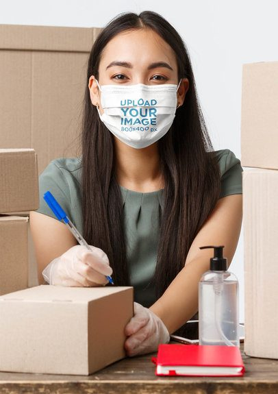 Face Mask Mockup of a Young Woman Surrounded by Shipping Boxes 42851-r-el2