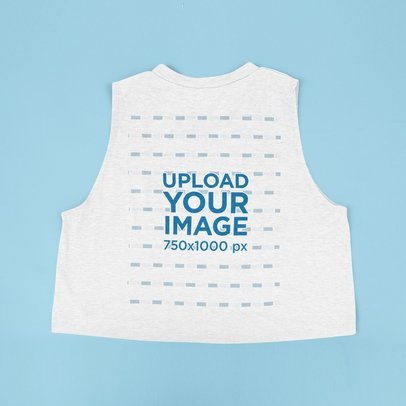Back View Mockup Featuring a Crop Tank Top Placed on a Colored Surface 43275