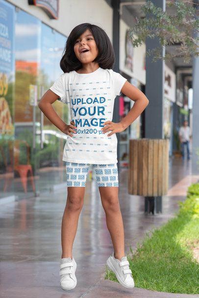 T-Shirt and Bike Shorts Mockup Featuring a Girl Jumping 42371