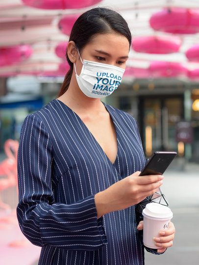 Face Mask Mockup Featuring a Serious Woman Checking Her Phone 42189-r-el2