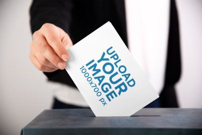 Mockup of a Man Putting a Horizontal Flyer into a Ballot Box 42257-r-el2