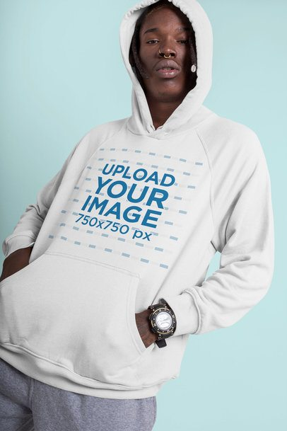 Hoodie Mockup of an Edgy Man with a Defiant Pose in a Studio 42982