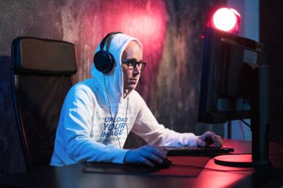 Mockup of a Gamer Wearing a Hoodie While Playing 42587-r-el2