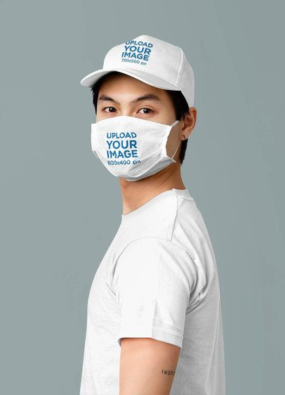 Face Mask and Hat Mockup of a Man Posing in a Studio 42860-r-el2