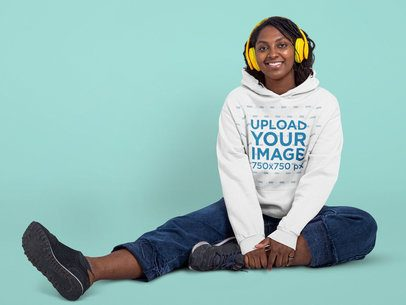 Hoodie Mockup Featuring a Happy Woman Listening to Music at a Studio 42990