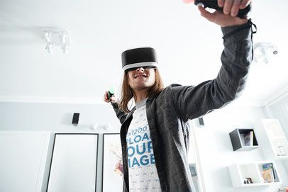 T-Shirt Mockup of a Man Playing a VR Game at Home 42747-r-el2