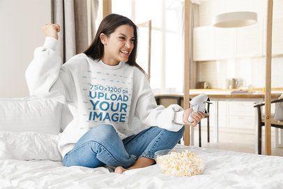 Sweatshirt Mockup of a Woman Playing Video Games at Home 42771-r-el2