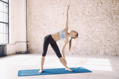 Sports Bra and Yoga Mat Mockup Featuring a Young Woman Doing Yoga 37837-r-el2