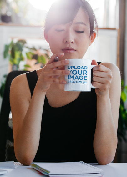 Mockup of a Woman Drinking From an 11 oz Coffee Mug While Working 43555-r-el2
