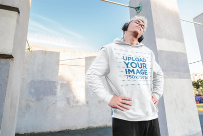 Hoodie Mockup Featuring a Man With Headphones Stretching His Neck 40045-r-el2