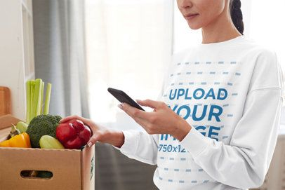 Sweatshirt Mockup Featuring a Woman with a Vegetables Box at Home 41761-r-el2