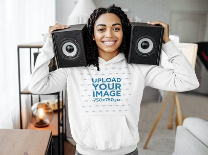 Hoodie Mockup of a DJ Holding Two Loud Speakers 39076-r-el2