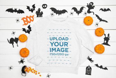 Mockup of a Flat Laid Sweatshirt Featuring a Halloween Decoration m92