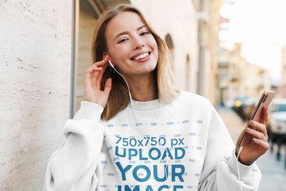 Mockup of a Happy Woman with a Sweatshirt Putting Headphones On 39825-r-el2